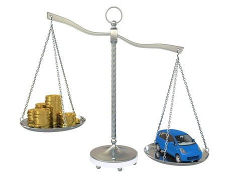 a-scale-weighing-coins-and-a-car