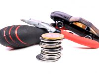 stack-of-coins-tools-and-a-toy-car