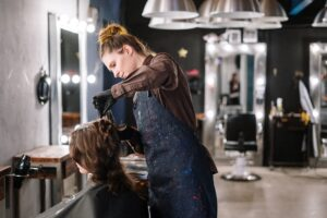 Woman cutting another woman's hair in salon