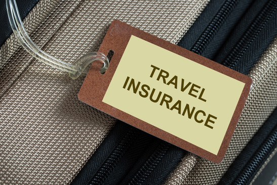 Travel-insurance-tag-tied-to-a-luggage