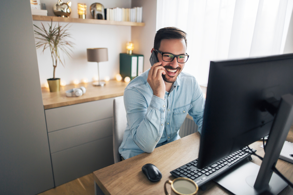 Man working from home in front of computer