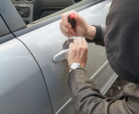 Thief-breaking-into-vehicle